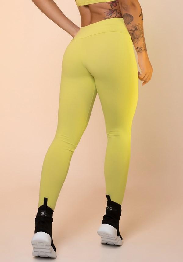 Calça legging amarela com recortes básica