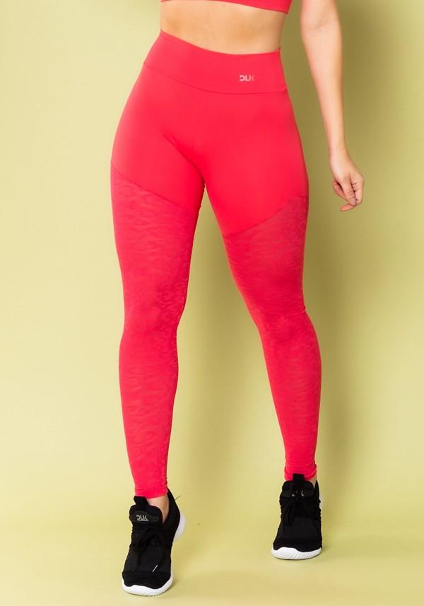 Calça legging energy com recorte em tela onça rosa