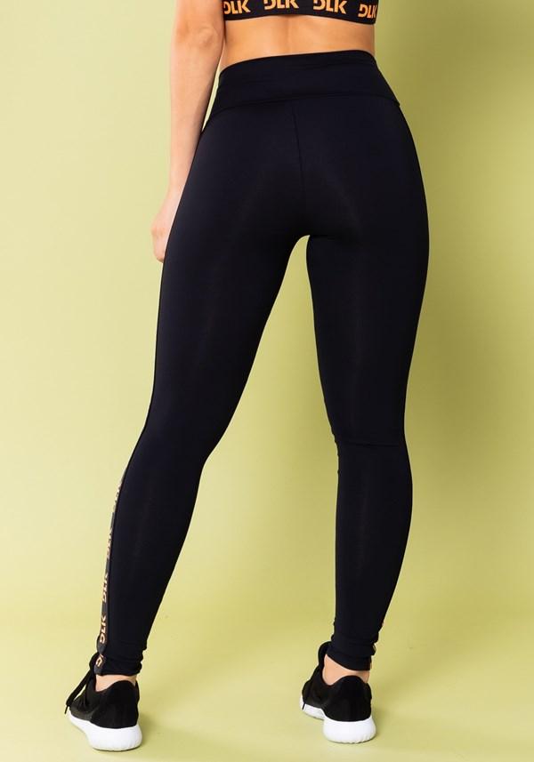Calça legging energy poliamida preta com elástico detalhe laranja