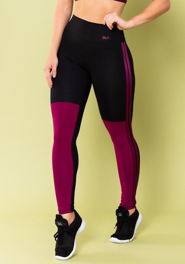 Calça legging energy preta com recorte e elástico roxo