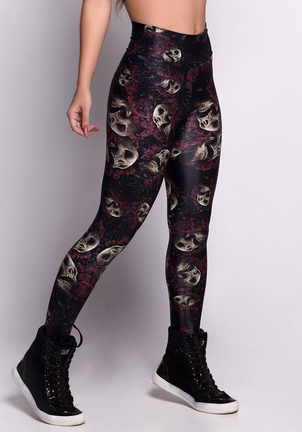 Calça legging glow preta com caveiras