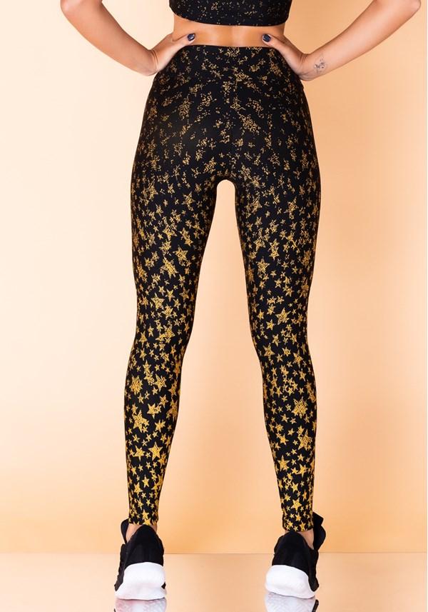Calça legging jacquard estrela dourada