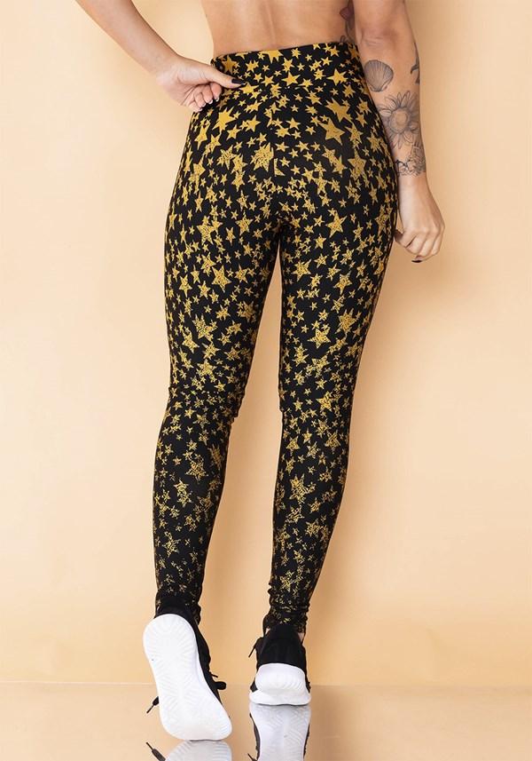 Calça legging jacquard estrela dourada reverse