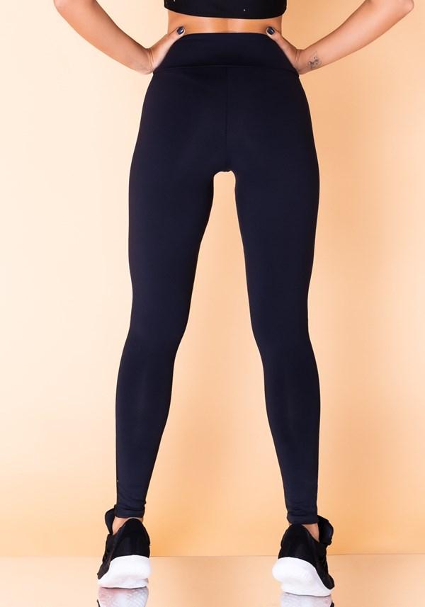 Calça legging jacquard preta lua e estrela branca reverse