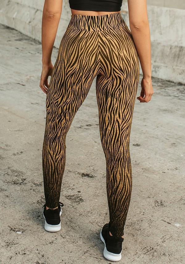 Calça legging jacquard zebra dourado reverse