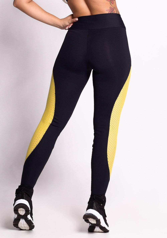 Calça legging poliamida preta com detalhes em dryfit amarela