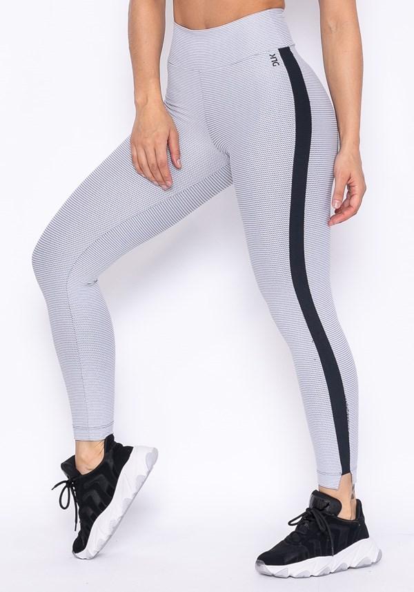 Calça legging technology branca com detalhe lateral preto