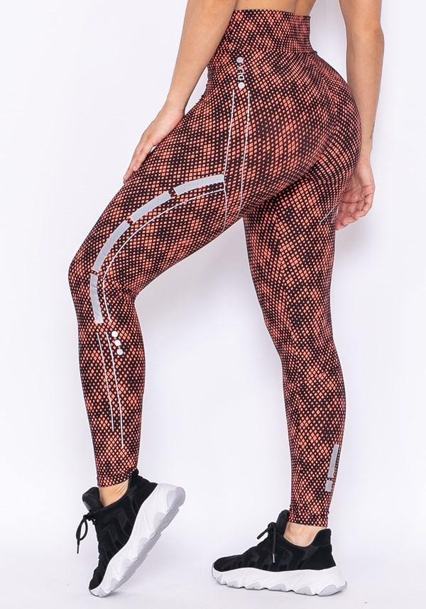 Calça legging technology com silk pixel preto e laranja