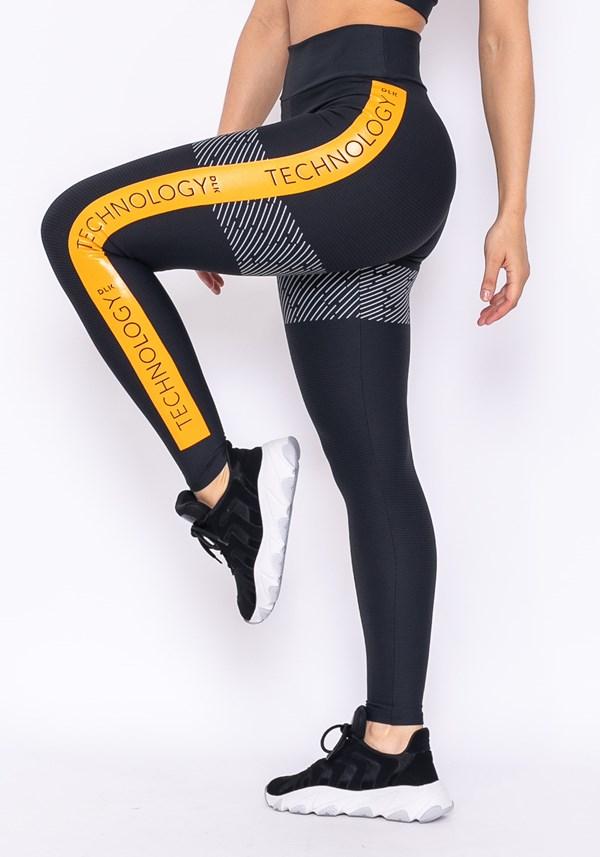 Calça legging technology preta com silk lateral amarelo ouro