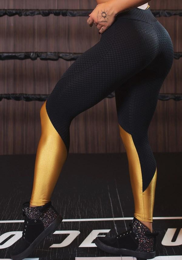 Calça legging texturizada com brilho dourado