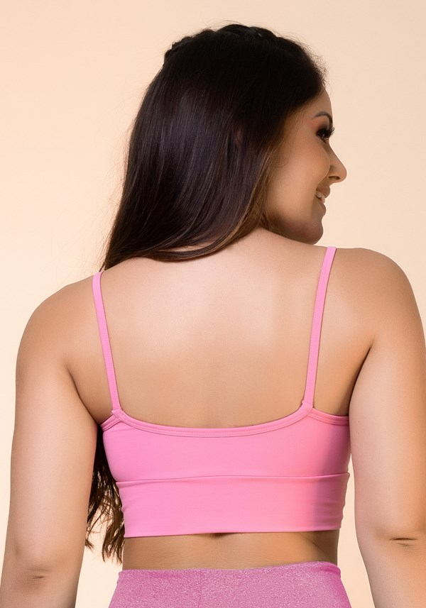 Top fitness rosa chiclete com recortes e bojo básico